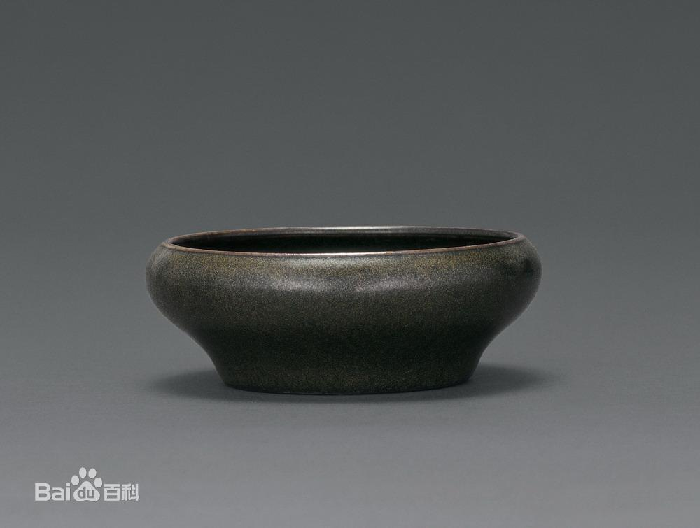 茶叶末釉是我国古代铁结晶釉中重要的品种之一,属高温黄釉,经高温还原图片