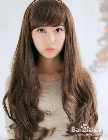 女人长发卷发发型图片