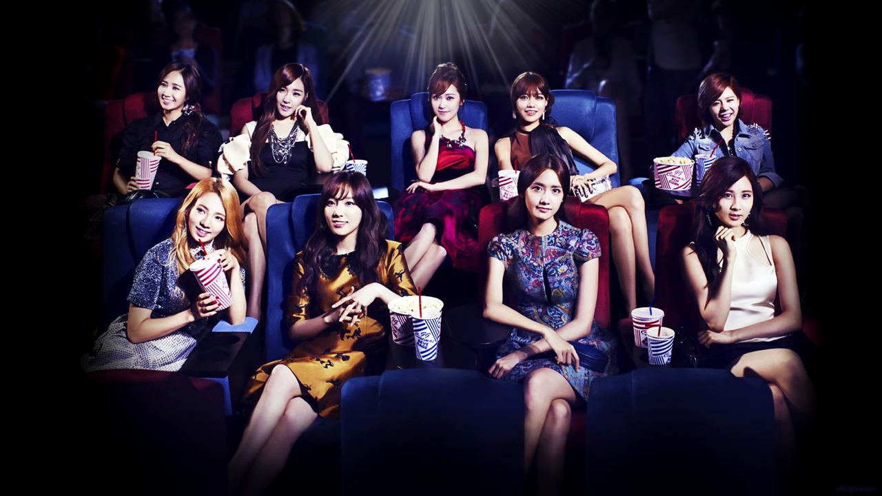 少女时代的海报里的一张她们去电影院拍摄的